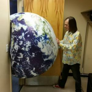Mikel tries to push the Earth Ball out the door.