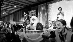 Santa Jumps out of a cake!